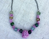 Necklace with mild lavender colored shibori silk from antique kimono and recycled glass beads.