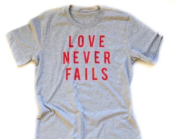 Love Never Fails Tee