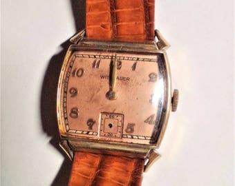EW!  Vintage 1940's mens Wittnauer wrist watch. Squarish style case is stamped 10k rolled gold. Watch IS NOT working now.Tan lizard strap.