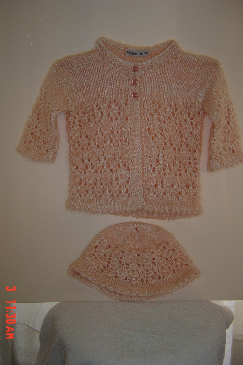 Fits baby size 6-12 moths. Hand knit with lacy design baby girl cardigan sweater with matching hat