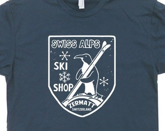 5926c27b Swiss Alps Ski T Shirt Cool Vintage Skiing Shirts For mens womens kids  Penguin Zermatt Switzerland Retro Utah Colorado Vermont Tee Snowboard