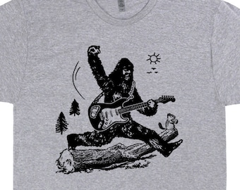 8a965c8c6b2 Sasquatch Electric Guitar T Shirt Bigfoot Playing Guitar Shirt Cool Vintage  Graphic Rock Tees Gift For Mens Women Kids Guitarist TShirts