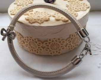 Faux stiched leather creamy bracelet, with charms