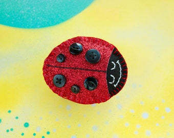 Sparkly ladybird badge / ladybug brooch / pin made with glitter fabric and felt