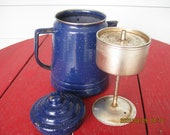 Blue speckled Enamel ware coffee pot with stem and basket to perk coffee. Old antique farmhouse kettle for the stovetop or over a campfire