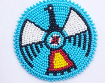 2 . 5 inch Coloured Thunderbird on Blue Beaded Rosette
