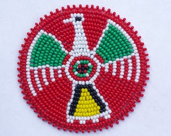 2 . 5 inch Coloured Thunderbird on RED Beaded Rosette