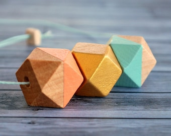 Wooden geo necklace. Peach and Mint.