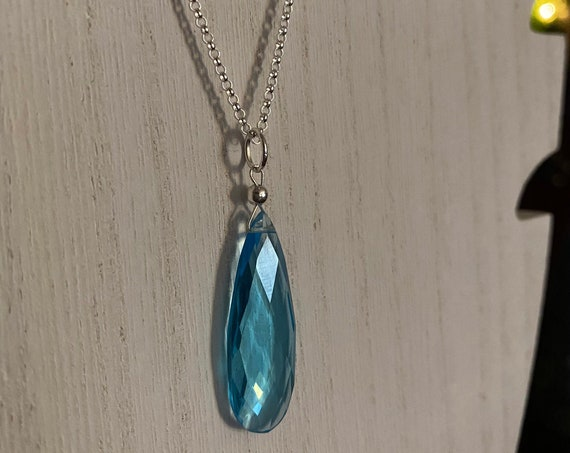 """Blue Topaz pendant on a 18"""" sterling silver rolo link chain. December birthstone"""