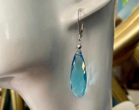 Beautiful long tear drop shaped Blue Topaz dangle earrings with sterling silver leverbacks. December's birthstone.
