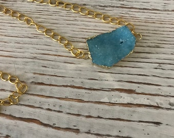 Gold plated chain necklace with baby blue druzy pendant