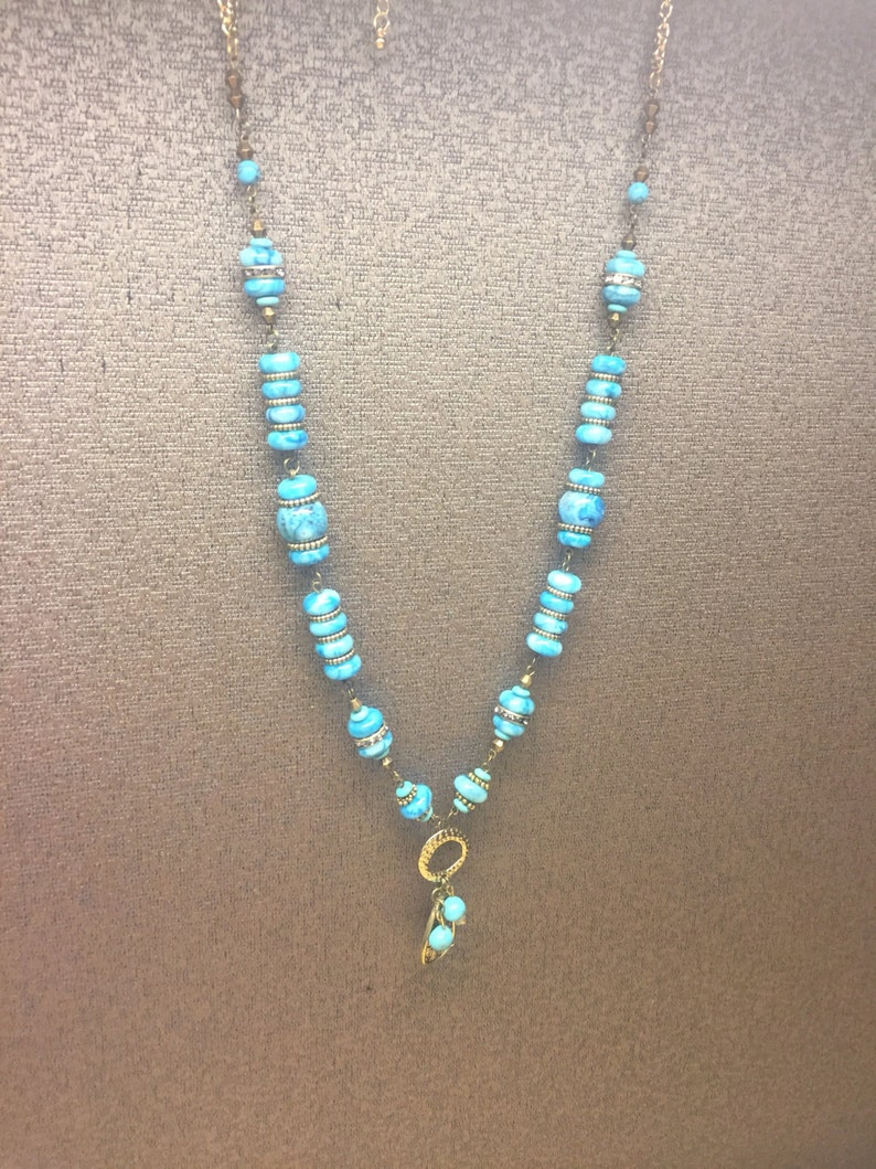 Long beaded turquoise and gold boho statement necklace