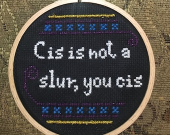 Cis is not a slur, you cis - handmade embroidery by Sophie Labelle