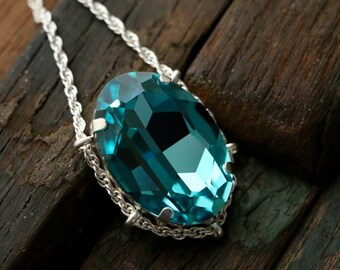 Swarovski Light Turquoise Crystal Cradle Pendant in Sterling Silver