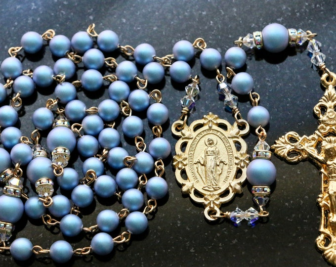 Featured listing image: Catholic Swarovski Iridescent Light Blue Crystal Pearl Rosary in Gold