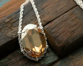 Swarovski Golden Shadow Crystal Cradle Pendant in Sterling Silver