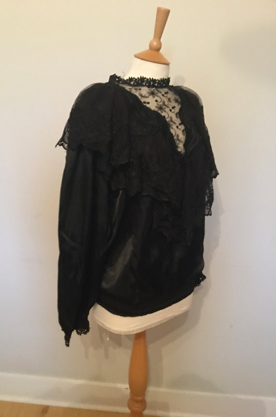 A 1980s does victorian gothic black satin blouse w