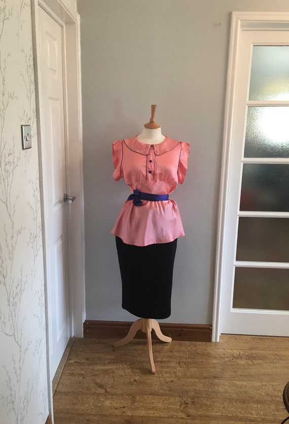 A lovely 1960s baby pink silk shirt with electric