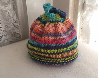5073720b6c2 Beautiful striped hand knit baby hat with curly top