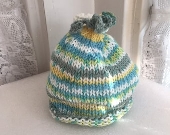 2bc7a7c0f8e Green striped hand knit baby hat with curly top
