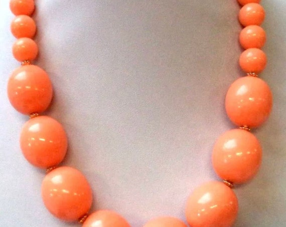 Light peachy Tangerine Orange Graduated Large Plastic Beads from Hong Kong