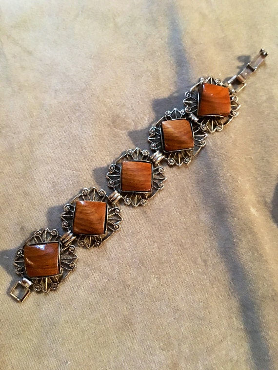 Ornate Goldtone clasp bracelet with polished natural wood inlays different unusual 70's mid century