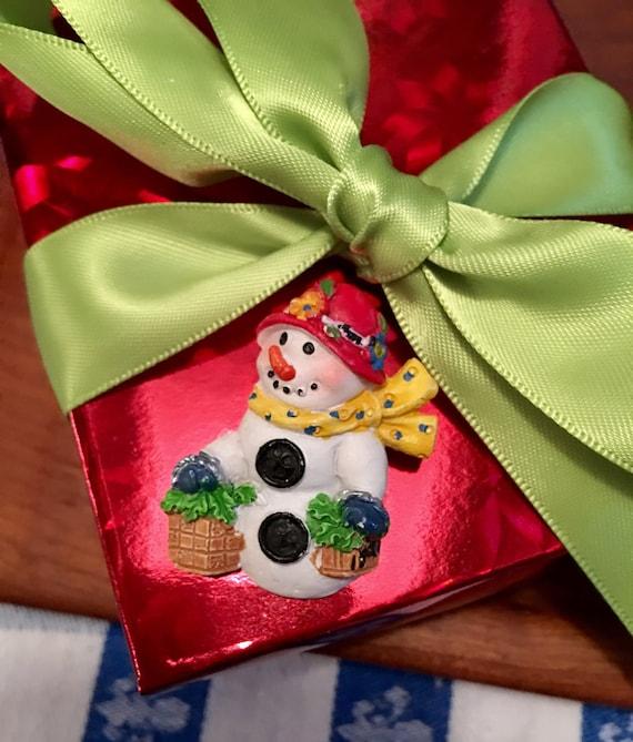 Vintage resin Christmas snowwoman in red hat  by Carol Eldridge comes giftboxed & ribboned