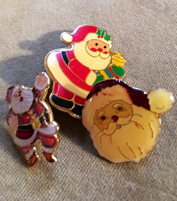 Three vintage enamel finished Christmas Santa  pins wear them togther or festively apart