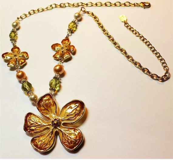 Peachy  golden enameled flowers accented with crystals & pearlized beads make this signed statement necklace on gold links