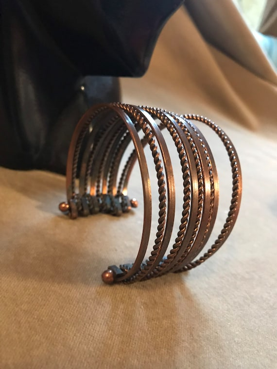 A Nifty Boho Glamour Gringe Bronzy Coopertone Modernist Cuff of Ten Connected Demi Bangles