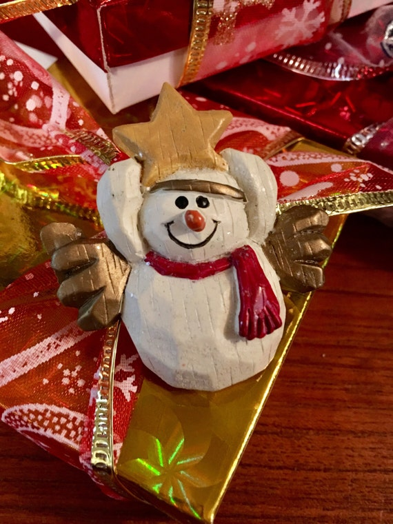 Vintage Christmas snowman holding a star pin comes giftboxed & ribboned