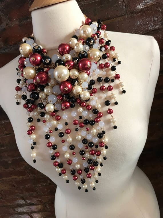 Beautiful Cascading Waterfall Bib Necklace Of Maroon Beige & Black Faux Pearls with Goldtone Chain and tiny flowered hardware
