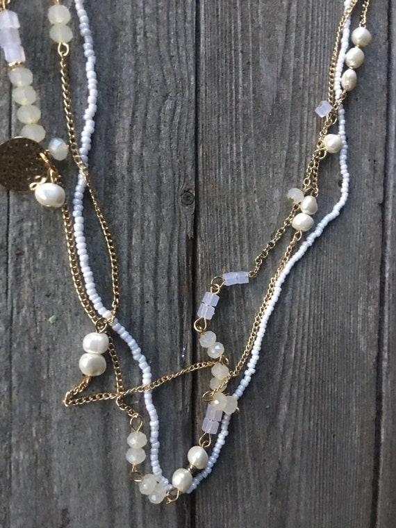 A Long Vintage triple Strand necklace of White Seed Beads Fresh Water Pearls Goldtone Chain Crystals & Bling