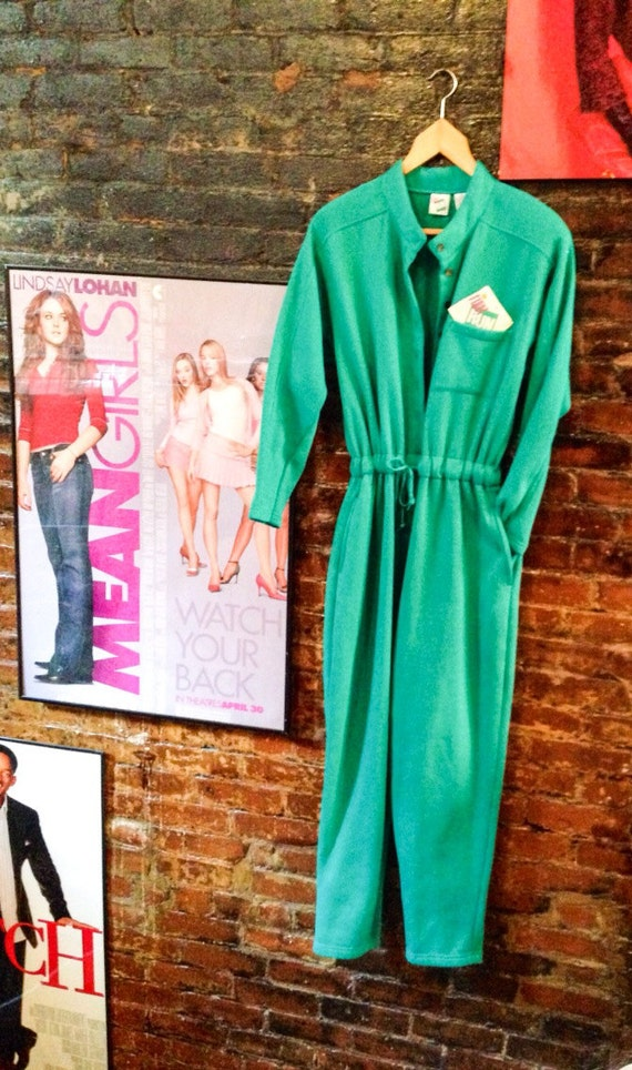 Vintage green fleece jumpsuit with shoulder pads unworn- tag in pocket- so '80's!