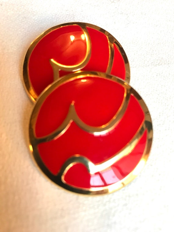 A Stunning Pair of Red Enamel on Goldtone Mid Century Modern Geometric Design Round Clip on Earrings