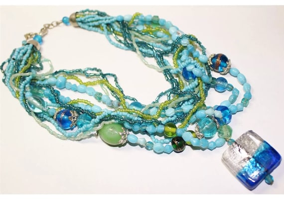 Vintage boho modernist  Multi Strand Blues & Greens Art Glass Beaded Necklace with Rainbow Pendant