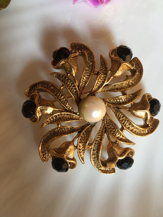 Ornate Victorian Rivival Golden Swirl Flower Statement Brooch with Black Crystals & a Pearl Center, now trending Unisex Lapel Pin
