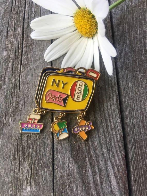 Signed 80's Vintage Jacket Pin Yellow Enamel Travel Suitcase Paris NY Rome & dangling charms Plane Ship palm tree Vacation Brooch