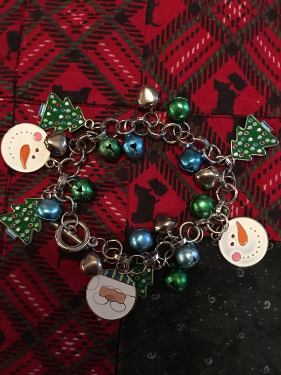 Vintage Christmas holiday charm bracelet with jingle bells & enamel snowmen and christmas trees
