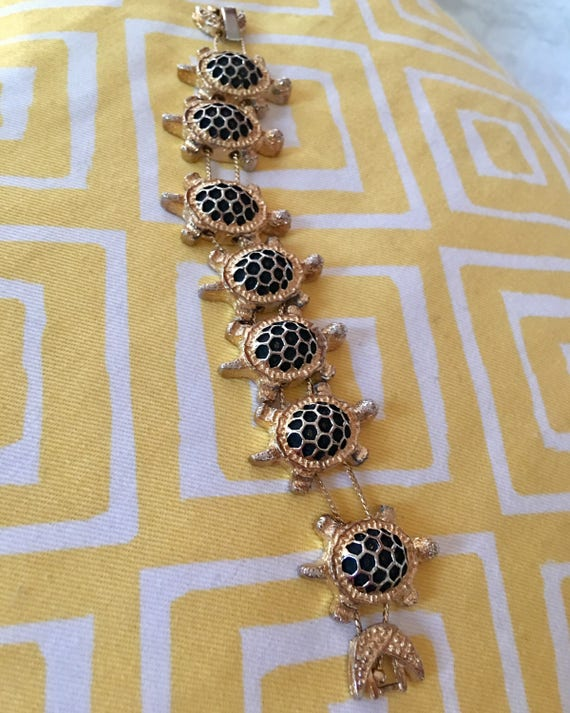 1993 Signed BG Turtle Slide Bracelet, Seven Black & Gold Turtles connected by chain with a half moon clasp linked Statement Bracelet