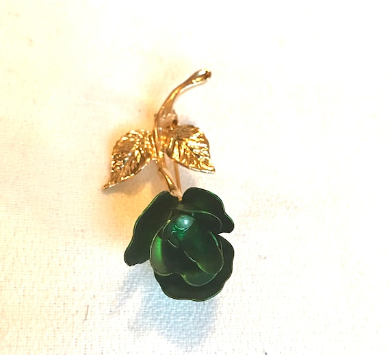 The Vintage Elegance Of a Single Matte Metalic Green Rose With with a pearl Center & Super Shiny Golden Stem