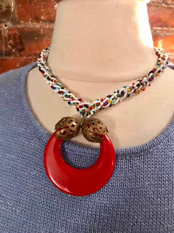 A Really Unusual Mid Century Funky Rainbow Seed Bead Choker Statement Necklace with a Red Lucite & Tribal Filagree Pendant