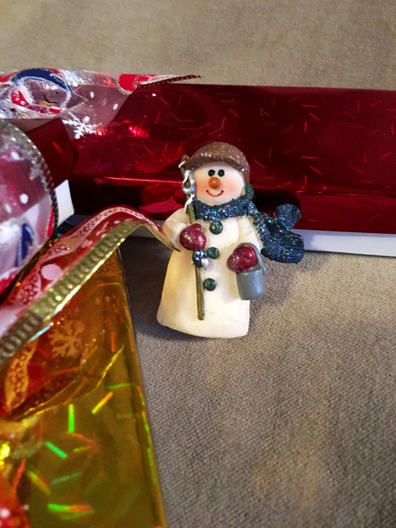 Vintage resin sparkly Christmas snowman holding a snow bucket  comes giftboxed & ribboned