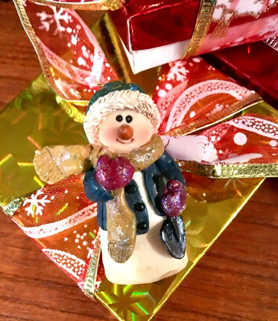 Vintage resin sparkly Christmas snowman holding a snow shovel comes giftboxed & ribboned
