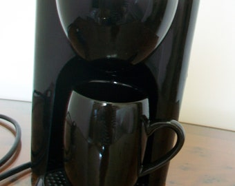 Unusual miniature filter coffee machine with mug