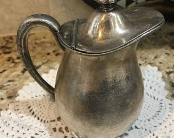 Antique creamer pitcher. Silver-plate, james w tuft