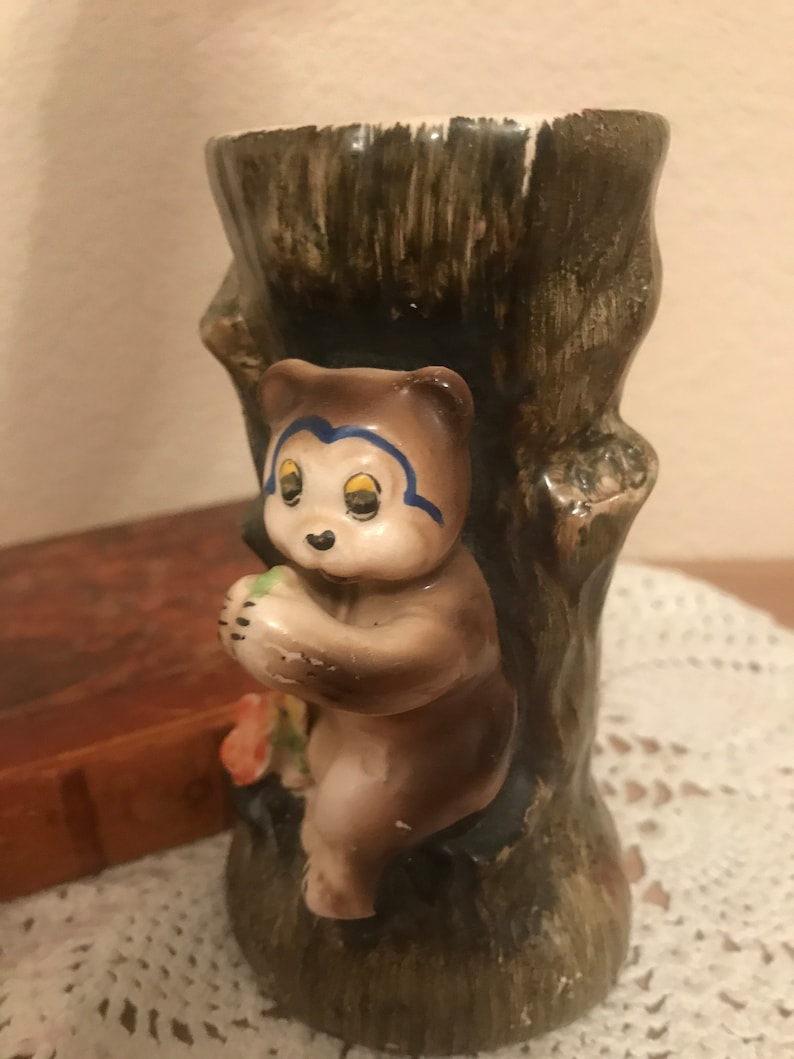 Vintage porcelain Bear and tree trunk vase planter.
