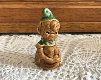 Vintage house elf miniature figurine.