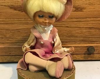 Vintage big eye doll music box. Japan, 1960's