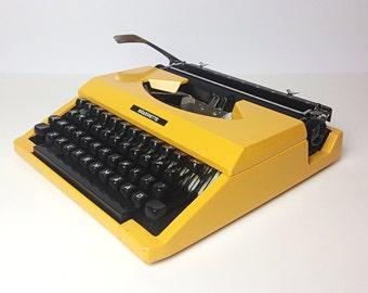 Yellow vintage typewriter / Silver Reed Silverette / Mono ink, new ribbon / Japan 70s